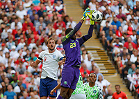 Football - 2018 International Friendly (pre-World Cup warm-up) - England vs. Nigeria<br /> <br /> Francis Uzoho (Nigeria) collect the high ball in front of Harry Kane (England) at Wembley Stadium.<br /> <br /> COLORSPORT/DANIEL BEARHAM