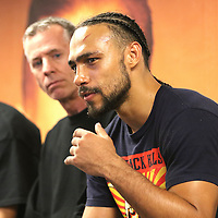 Keith Thurman speaks to the media about fighting world champion Floyd Mayweather Jr. after his victory over Luis Collazo during the Premier Boxing Champions boxing match for the WBA Welterweight title on ESPN at the USF Sun Dome, on Saturday, July 11, 2015 in Tampa, Florida.  Thurman won the bout when the corner of Collazo stopped the fight at the beginning of the eighth round. (AP Photo/Alex Menendez)