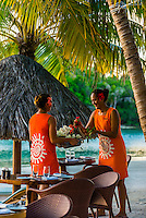 Waitresses setting tables at the Tere Nui Restaurant, Four Seasons Resort Bora Bora, Motu Tehotu, Bora Bora, French Polynesia.