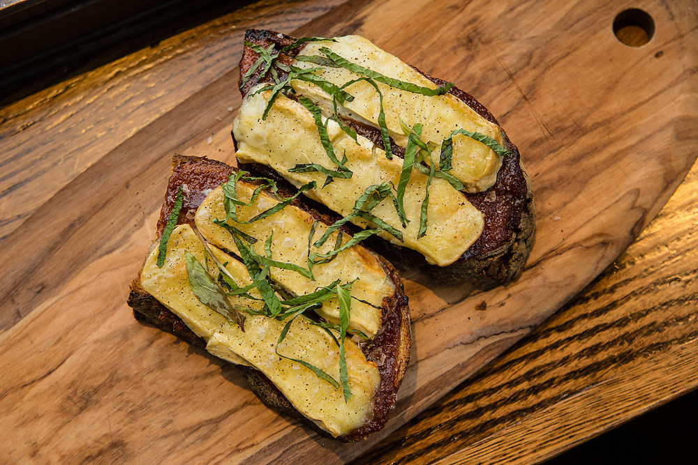 Astoria, NY - 8 December 2016. seasonal toast, with pear butter with cinnamon, brie and herbs at The Pomeroy.