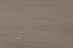 28 June 2005: a golf ball comes to rest in a sand trap.