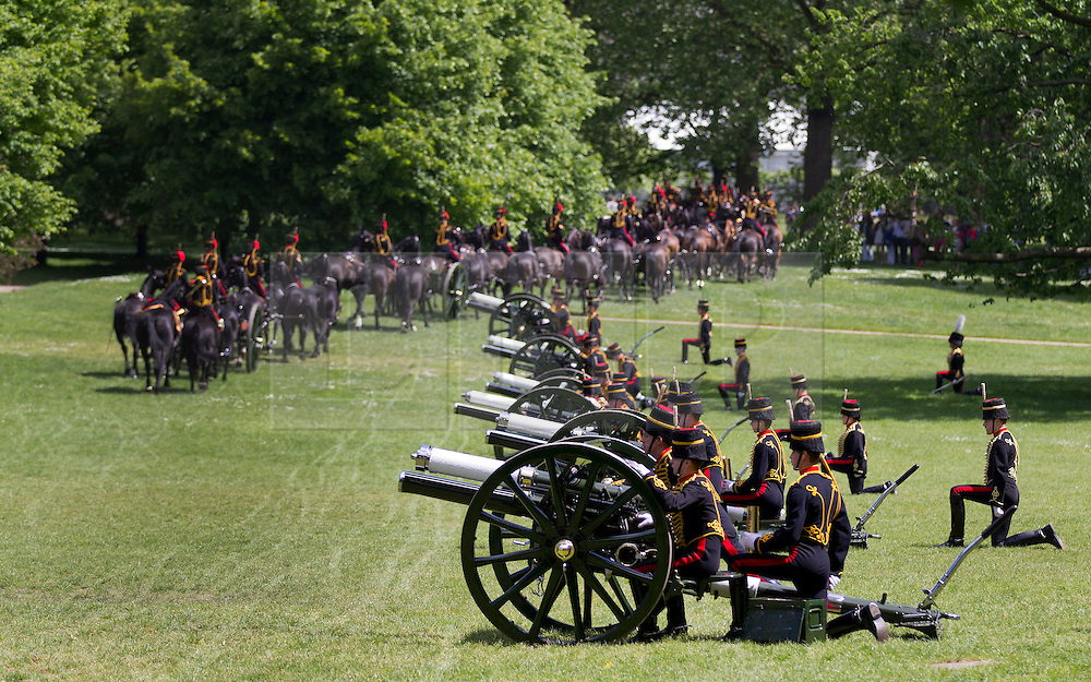 © Licensed to London News Pictures. 03/06/2013. London, UK. Gunners of the King's Troop Royal Horse Artillery, the ceremonial saluting battery of the Household Division, prepare to fire a 41 gun ceremonial salute in Green Park London today (03/06/2013) in honour of the 60th Anniversary of the Coronation of Her Majesty The Queen. Photo credit: Matt Cetti-Roberts/LNP