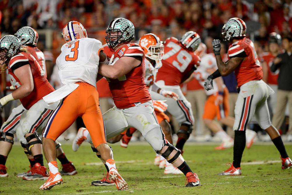 January 3, 2014: Vic Beasley #3 of Clemson is blocked by Jack Mewhort #74 of Ohio State during the NCAA football game between the Clemson Tigers and the Ohio State Buckeyes at the 2014 Orange Bowl in Miami Gardens, Florida.  The Tigers defeated the Buckeyes 40-35.