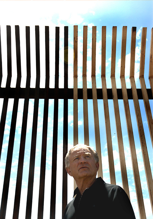 Douglas, Arizona mayor Ray Borane stands in front of the fence which separates both Douglas, Arizona from Agua Prieta, Mexico, as well as the U.S. from Mexico. Many Mexican citizens have cut through this fence in order to find a new life in the U.S.