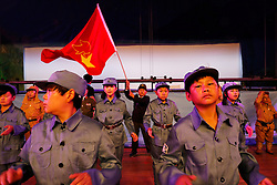 Members of 'Longzaitian' or 'Dragon in the Sky' Shadow Puppet Troupe dressed in Communist Party Red army uniforms perform in a rehearsal for a show titled 'Findling the Anti-Japanese Hero' in Beijing, China, 29 May 2015. The troupe which consists of about 50 members who look like children but are actually dwarfs with an average age of 22 and height of 1.26 metres. Formed in 2008, the troupe started out with less than ten members but gradually grew in fame and stature, drawing many other dwarfs from all parts of China who seek to be accepted in a community of their own. The troupe provides training, food, accommodation and income for the members as well as a sense of belonging and pride in their work preserving the ancient art of shadow puppetry. Dwarfs have traditionally been viewed as disabled people in China and are often discriminated by mainstream society.