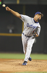 Phoenix, AZ 07-18-04 L.A.Dodgers' Jose Lima pitches in the first inning. Lima threw for 8 innings allowing 10 hits and 3 runs. The Dodgers went on to win 10-3 to sweep the 4 game series against the Arizona Diamondbacks. Ross Mason photo