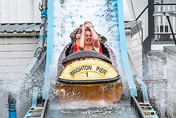 © Licensed to London News Pictures. 25/05/2019. Brighton, UK.  Members of the public take a ride on the Brighton Palace Pier Big Splash water attraction on the May Bank holiday Saturday. Photo credit: Hugo Michiels/LNP