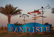 Whimsical metal sculptures decorate the entrance to Grand Isle, a barrier island situated on the Gulf of Mexico at the southernmost tip of Louisiana, Nov. 23, 2010. The area was heavily affected when the Deepwater Horizon oil rig exploded April 20, 2010, killing 11 workers and causing the largest offshore oil spill in United States history. (Photo by Carmen K. Sisson/Cloudybright)