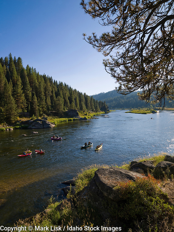 White water rafters enjoy the warmth of the sun after a run on the Carbarton section of the Payette River.