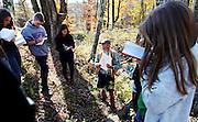 Teacher Pat Barnes, facing center, teaches an environmental science class in the woods at the Mountain School..