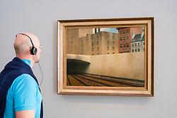Man looking at painting  Approaching a City by Edward Hopper, at exhibition of American art , From Hopper to Rothko at the Barberini Museum in Potsdam , Germany . Editorial Use Only