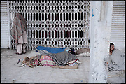 """Homeless and heroin users slowly wake up early in the morning. Morgh Mandi, Rawalpindi, Pakistan, on thursday, November 27 2008.....""""Pakistan is one of the countries hardest hits by the narcotics abuse into the world, during the last years it is facing a dramatic crisis as it regards the heroin consumption. The Unodc (United Nations Office on Drugs and Crime) has reported a conspicuous decline in heroin production in Southeast Asia, while damage to a big expansion in Southwest Asia. Pakistan falls under the Golden Crescent, which is one of the two major illicit opium producing centres in Asia, situated in the mountain area at the borderline between Iran, Afghanistan and Pakistan itself. .During the last 20 years drug trafficking is flourishing in the Country. It is the key transit point for Afghan drugs, including heroin, opium, morphine, and hashish, bound for Western countries, the Arab states of the Persian Gulf and Africa..Hashish and heroin seem to be the preferred drugs prevalence among males in the age bracket of 15-45 years, women comprise only 3%. More then 5% of whole country's population (constituted by around 170 milion individuals),  are regular heroin users, this abuse is conspicuous as more of an urban phenomenon. The substance is usually smoked or the smoke is inhaled, while small number of injection cases have begun to emerge in some few areas..Statistics say, drug addicts have six years of education. Heroin has been identified as the drug predominantly responsible for creating unrest in the society."""""""