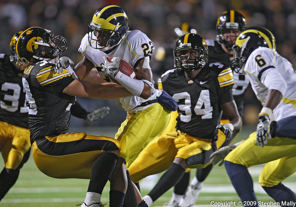 October 10, 2009: Michigan wide receiver Darryl Stonum (22) is hit by Iowa linebacker Jeff Tarpinian (33) during the first half of the Iowa Hawkeyes' 30-28 win over the Michigan Wolverine's at Kinnick Stadium in Iowa City, Iowa on October 10, 2009.