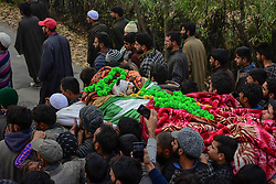 November 10, 2018 - Pulwama, J&K, India - (EDITORS NOTE: Image depicts death.)  Kashmiri mourners are seen carrying  the dead body of a local rebel, Wajid Ahmad during his funeral procession in Pulwama, south of Srinagar, Indian administered Kashmir..Thousands of people attend the funeral prayers of the two Hizbul Mujahideen militants that were killed by the government forces in an encounter in Tikken area of south Kashmir's Pulwama. (Credit Image: © Saqib Majeed/SOPA Images via ZUMA Wire)