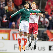 HARRISON, NEW JERSEY- APRIL 10: Alan Pulido #9 of C.D. Guadalajara is challenged by Tim Parker #26 of New York Red Bulls during the New York Red Bulls Vs C.D. Guadalajara CONCACAF Champions League Semi-final 2nd leg match at Red Bull Arena on April 10, 2018 in Harrison, New Jersey. (Photo by Tim Clayton/Corbis via Getty Images)
