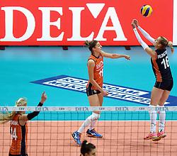 03-10-2015 NED: Volleyball European Championship Semi Final Nederland - Turkije, Rotterdam<br /> Nederland verslaat Turkije in de halve finale met ruime cijfers 3-0 / Anne Buijs #11, Debby Pilon-Stam #16