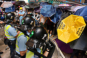 Police in riot gear facing students using umbrellas to protect from pepper spray<br /> <br /> Violent clashes in Mong Kok, Protesters form new blockades after a night of chaotic clashes with police<br /> <br /> 20th day of pro-democracy protest in Hong Kong