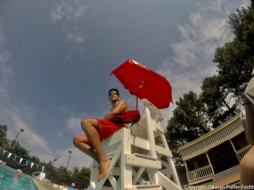 A lifeguard works during a water aerobics class.