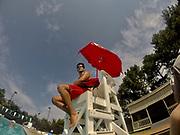 A lifeguard works during a water aerobics class.