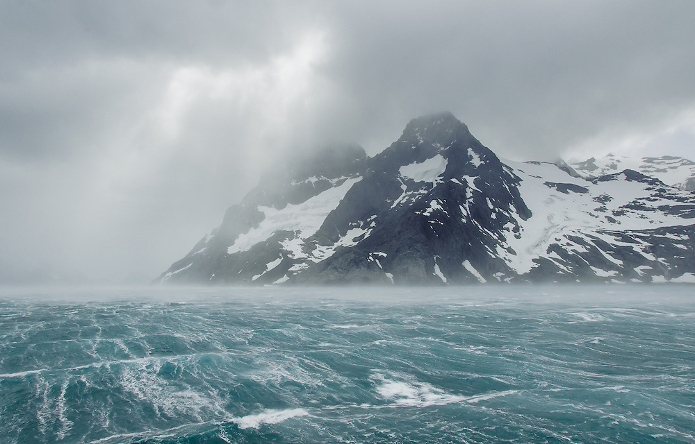Storm in Drygalski Fjord, South Georgia. The strong winds of Antarctica are called katabatics, formed by cold, dense air flowing out from the polar plateau of the interior down the steep vertical drops along the coast.