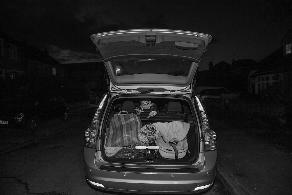 Ben dressed as Spiderman looks out from the back of our Volvo Estate in Berkhamsted, England Tuesday, Feb. 24, 2015 (Elizabeth Dalziel) #thesecretlifeofmothers #bringinguptheboys #dailylife
