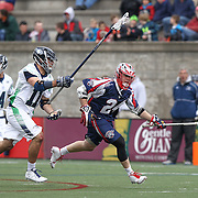 Chris Eck #24 of the Boston Cannons runs with the ball past Alex Smith #11 of the Chesapeake Bayhawks during the game at Harvard Stadium on April 27, 2014 in Boston, Massachusetts. (Photo by Elan Kawesch)