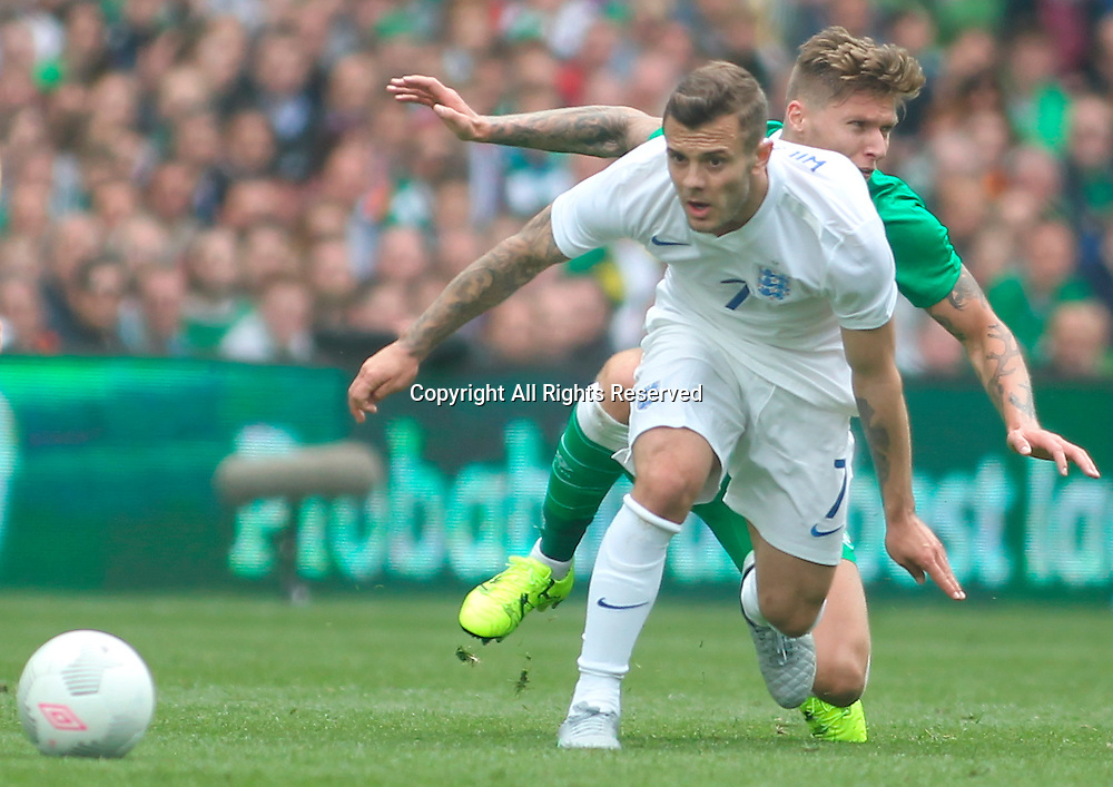 07.06.2015.  Dublin, Ireland. International Football Friendly. Republic of Ireland versus England. Jack Wilshere (England) holds off a challenge from Jeff Hendrick (Rep. of Ireland).