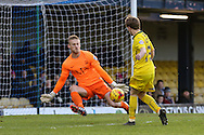 Andy Kellett of Plymouth Argyle (right) shoots but his shot is saved by Daniel Bentley of Southend (left) during the Sky Bet League 2 match at Roots Hall, Southend<br /> Picture by David Horn/Focus Images Ltd +44 7545 970036<br /> 10/01/2015