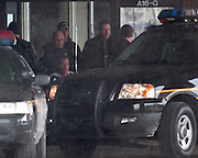 Macomb County Sheriff deputies transfer murder suspect Stephen Grant (in wheel chair) into a waiting vehicle for transfer back to Macomb County from Emmet County.
