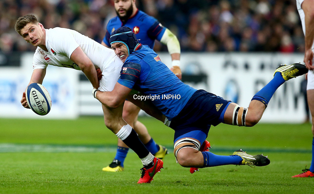 RBS 6 Nations Championship Round 5, Stade de France, Paris, France 19/3/2016<br /> France vs England<br /> England's Owen Farrell offloads as he is tackled by Bernard le Roux of France<br /> Mandatory Credit &copy;INPHO/James Crombie
