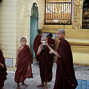 May 09, 2013 - Yangon, Myanmar: Buddhist novices take photographs during a visit to Sule Pagoda in central Yangon. (Paulo Nunes dos Santos/Polaris)
