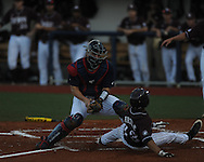 Ole Miss catcher Stuart Turner tags out Mississippi State's Brett Pirtle at Oxford-University Stadium in Oxford, Miss. on Saturday, May 11, 2013. Ole Miss won 10-8 in the second game of a doubleheader..