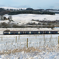 Perthshire Snowfall…06.02.18<br />A Scotrail train from Perth to Glasgow makes its way through a snow covered Strathearn Valley after overnight snow fell across Perthshire<br />Picture by Graeme Hart.<br />Copyright Perthshire Picture Agency<br />Tel: 01738 623350  Mobile: 07990 594431