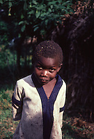 A pygmy boy poses for the camera in a Zaire village.