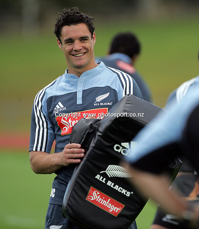 All Black five eighth Dan Carter is all smiles during the All Blacks training session at Waitakere, Auckland, on Tuesday 25 October, 2005. Photo: Andrew Cornaga/PHOTOSPORT<br />