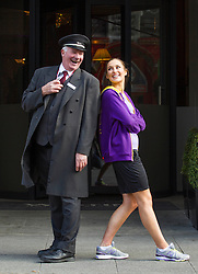 Repro Free: 05/03/2013 Doorman Peter Nolan is pictured helping Model Roz Purcell limber up at the launch of the New Balance Gear lending initiative in The Westin Dublin as she prepares to lead approximately 50 associates, guests and friends of the hotel on a 5k run around the city in aid of children's charity Barretstown. For just ?5, guests of The Westin Dublin can now borrow running shoes with disposable insoles, as well as a variety of men's and women's New Balance apparel, enabling more travellers to stay healthy and fit on the road.  www.thewestindublin.com Picture Andres Poveda
