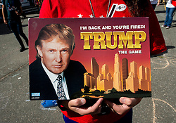 Sept.26, 2016 - Hempstead, New York, U.S. -  A man holds a 'Trump The Game' by Parker Brothers at Hofstra University, site of the first of three scheduled debates between presidential candidates Hillary Clinton and Donald Trump. (Credit Image: © Brian Cahn via ZUMA Wire)