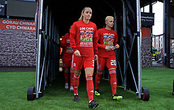 NEWPORT, WALES - Thursday, April 4, 2019: Wales' Gemma Evans (L) and Grace Horrell walk out of the players' tunnel, wearing a t-shirt marking 100 caps for Loren Dykes, before an International Friendly match between Wales and Czech Republic at Rodney Parade. (Pic by David Rawcliffe/Propaganda)