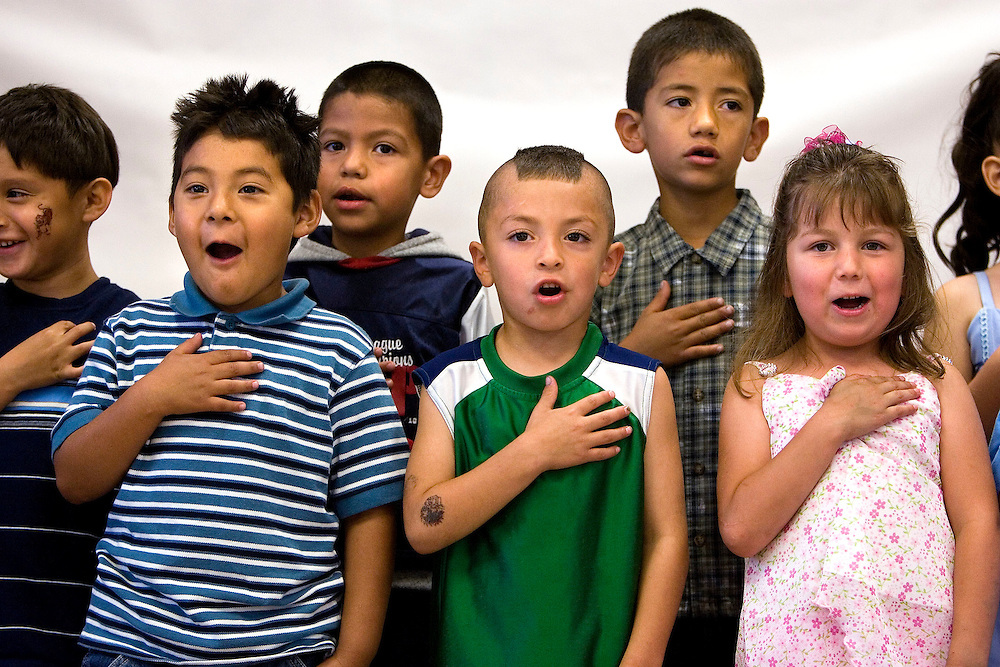 (from left) (front row) Luis Lugo, Elija Gonzales, and Rugy Guttierrez, (back row) Sergio Zavala, and Jesus Castro say the pledge of allegiance at the start of the graduation/promotion event at the Guadalupe School in Salt Lake City, Utah Friday, June 15, 2007.  August Miller/ Deseret Morning News
