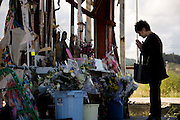 A visitor offers prayer at the makeshift alter in front of the Crisis Management Center in Minamisanriku Town, Miyagi Prefecture, Japan on 11 Sept. 2012, 18 months after the Great East Japan Earthquake and tsunamis it the Tohoku region. While other buildings such as the nearby Shizugawa municipal hospital have recently been torn down the fate of  disaster prevention center has yet to be decided. Photographer: Rob Gilhooly