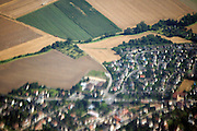 blurry view of a French village from airplane