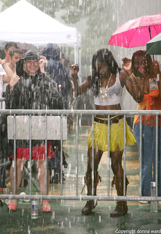 Dancing in the rain as Giant Step celebrates its 15th Anniversary at Central Park SummerStage on July 17, 2005.