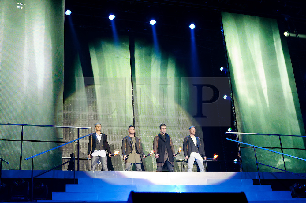 © Licensed to London News Pictures. 23/05/2012. London, UK. Westlife perform live at The O2 Arena, London, as part of their final ever farewell tour.   After the four burning effigies burnout, the curtain lifts to reveal Westlife themselves, carrying flaming torches as though symbolising the decision to break up being in their hands.  Westlife are an Irish boy band formed in 1998. They are to disband in 2012 after their farewell tour. The group's line-up was Shane Filan, Mark Feehily, Nicky Byrne, and Kian Egan.  Westlife have sold over 45 million records worldwide which includes studio albums, singles, video release, and compilation albums.  Photo credit : Richard Isaac/LNP