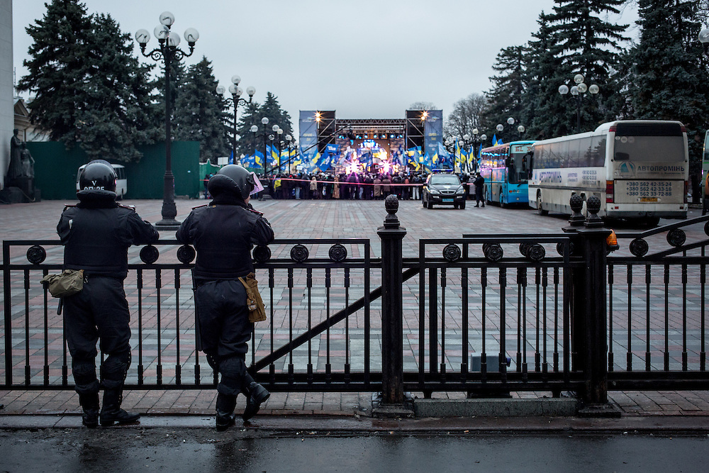 Two policemen guard the entrance of the pro-Yanoukovitch rally, in Marinski Park.