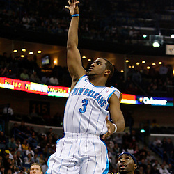 Dec 18, 2009; New Orleans, LA, USA;  New Orleans Hornets guard Chris Paul (3) shoots over Denver Nuggets guard Ty Lawson (3) during the first half at the New Orleans Arena. Mandatory Credit: Derick E. Hingle-US PRESSWIRE