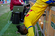 Crystal Palace forward Michy Batshuayi (23) as he tumbles over the led advertising boards in place during the The FA Cup 5th round match between Doncaster Rovers and Crystal Palace at the Keepmoat Stadium, Doncaster, England on 17 February 2019.