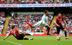 England's Dele Alli is fouled by Turkey's Gokhan Gonul - Mandatory byline: Matt McNulty/JMP - 07966386802 - 22/05/2016 - FOOTBALL - Etihad Stadium -Manchester,England - England v Turkey - International Friendly