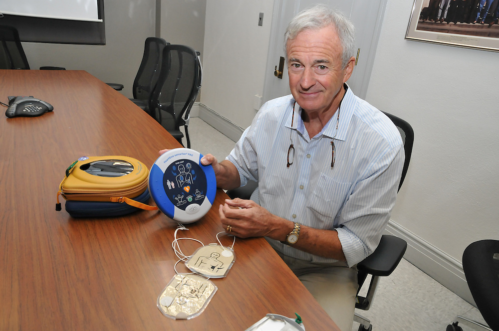 Dr. Carter Newton with an Automatic External Defibrillator.