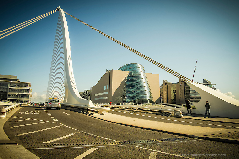 Dublin City, Ireland, 2012: The James Joyce Bridge crossing the river Liffey near the Dublin Port and the modern Docklands city quarter frames the new Dublin Convention Centre under it's steel suspension cables