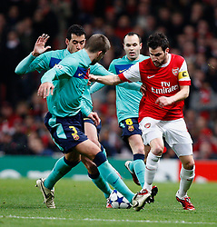 16.02.2011, Emirates Stadium, London, ENG, UEFA CL, FC Arsenal vs FC Barcelona, im Bild Arsenal's Cesc Fabregas (captain) with Barcelona's Gerard Pique  and Barcelona's Sergio Busquets   in Arsenal vs Barcelona for the UCL  ,Round of last 16, at the Emirates Stadium in London on 16/02/2011, EXPA Pictures © 2011, PhotoCredit: EXPA/ IPS/ Kieran Galvin +++++ ATTENTION - OUT OF ENGLAND/GBR and France/ FRA +++++